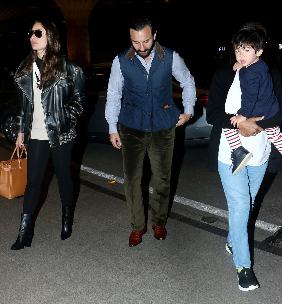 Kareena, Saif and Taimur spotted at Mumbai airport on their way to London.