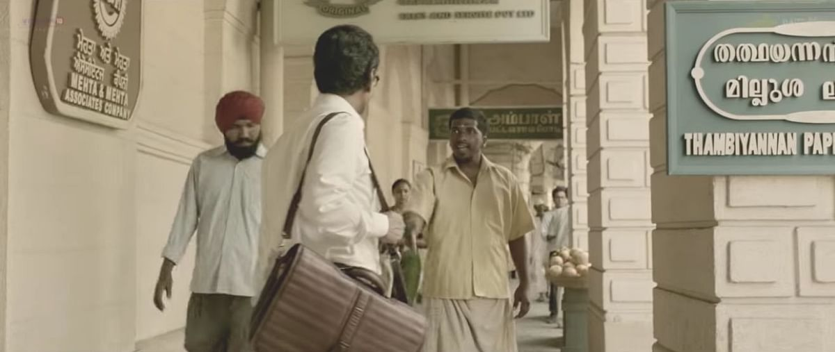 A South Indian berates a young Bal Thackeray for bumping into him. A still from the trailer of <i>Thackeray. </i>