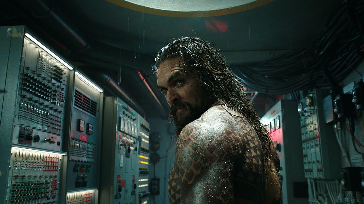 Jason Momoa in and as <i>Aquaman.</i>