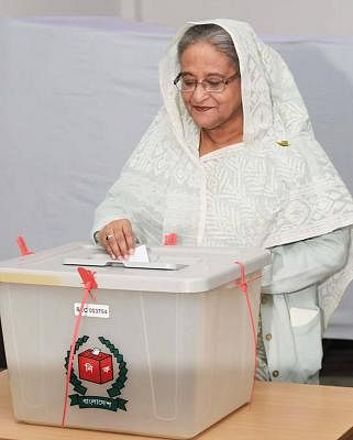 DHAKA, Dec. 30, 2018 (Xinhua) -- Bangladesh Prime Minister Sheikh Hasina casts her vote at a polling station in Dhaka, capital of Bangladesh, on Dec. 30, 2018. Nationwide voting opened Sunday morning in Bangladesh
