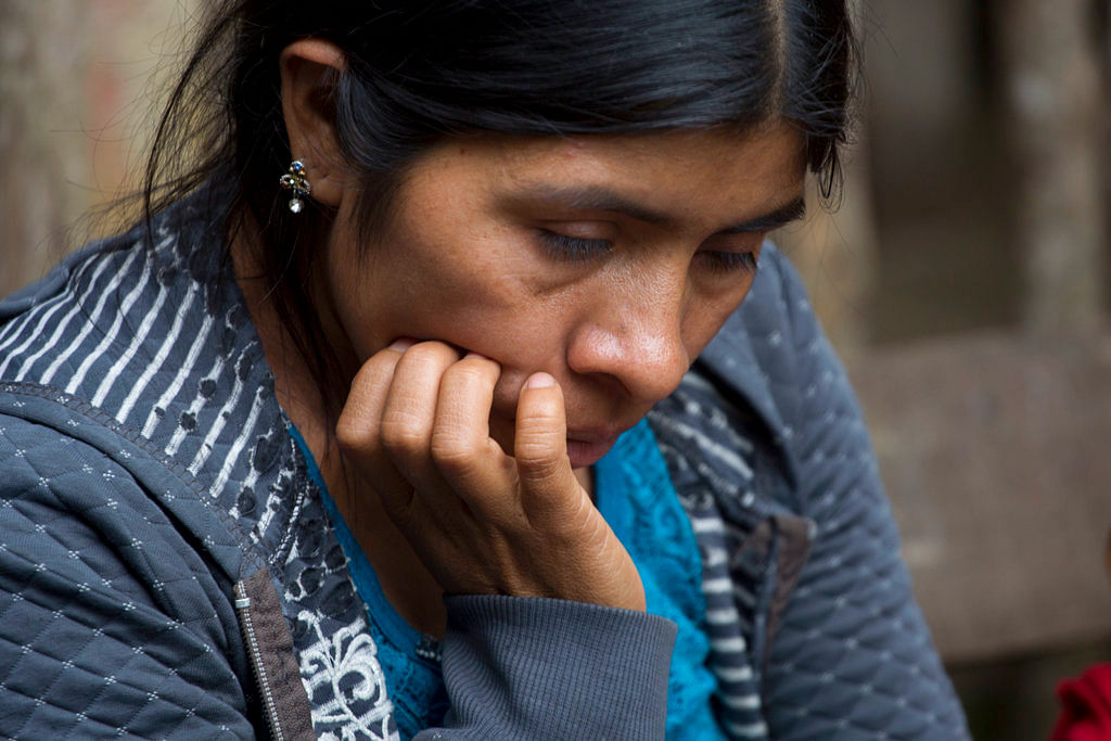 Catarina Alonzo Perez, the mother of Felipe Gomez Alonzo, the second Guatemalan child this month to die while in U.S. custody near the Mexican border, pauses during an interview in her home in Yalambojoch, Guatemala on 29 December 2018.
