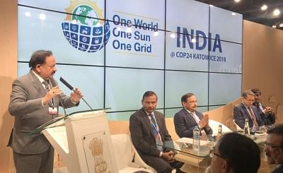 Katowice: Union Minister for Science & Technology, Earth Sciences and Environment, Forest & Climate Change, Dr. Harsh Vardhan addresses at the inauguration of the Indian Pavilion at COP24 in Katowice, Poland on Dec 3, 2018. Also seen Ministry of Environment, Forest and Climate Change Secretary C.K. Mishra. (Photo: IANS/PIB)