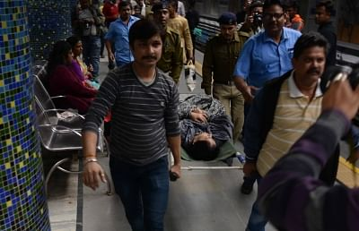 Kolkata: Passengers being taken for treatment after an air-conditioned rake of a metro train in Kolkata caught fire on Dec 27, 2018.