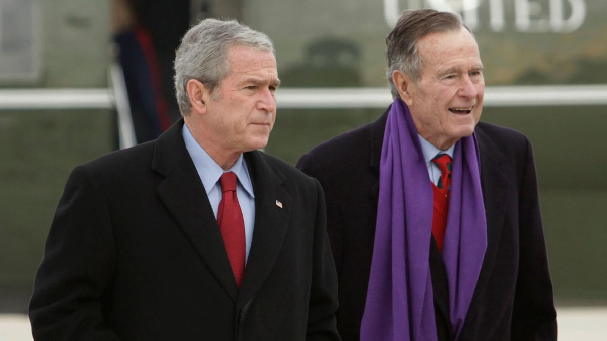 File photo of former US President George W Bush (L) walking with his father, another former US President George HW Bush.