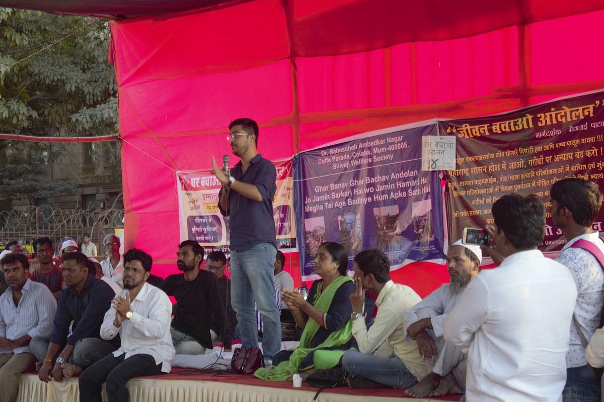 Activist Bilal Khan addresses the protesters.
