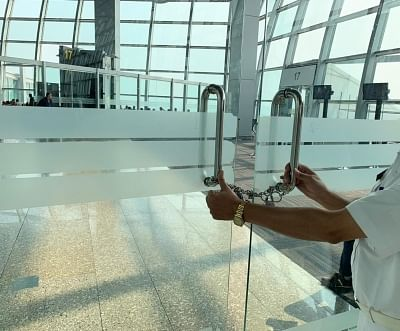 Kolkata: The chained glass door that separates the domestic departure security hold area from the international departure zone at Netaji Subhas Chandra Bose International Airport (NSCBI) in Kolkata. (Photo: IANS)