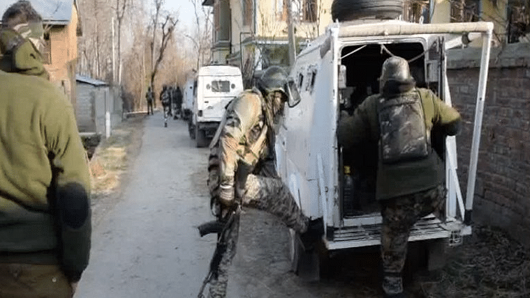 Security forces at the site of the Pulwama encounter.