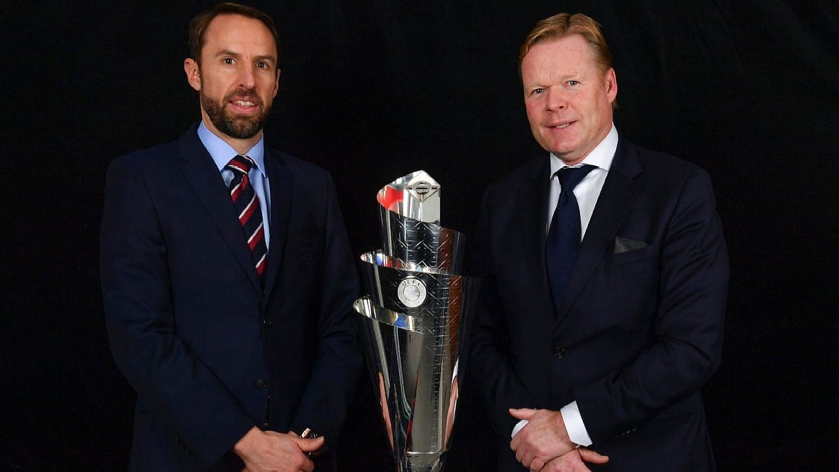 England manager Gareth Southgate (L) and Netherlands coach Ronald Koeman pose with the UEFA Nations League trophy.