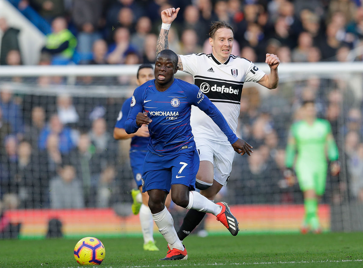 Chelsea's N'Golo Kante, left, challenges for the ball with Fulham's Stefan Johansen during the English Premier League soccer match between Chelsea and Fulham.