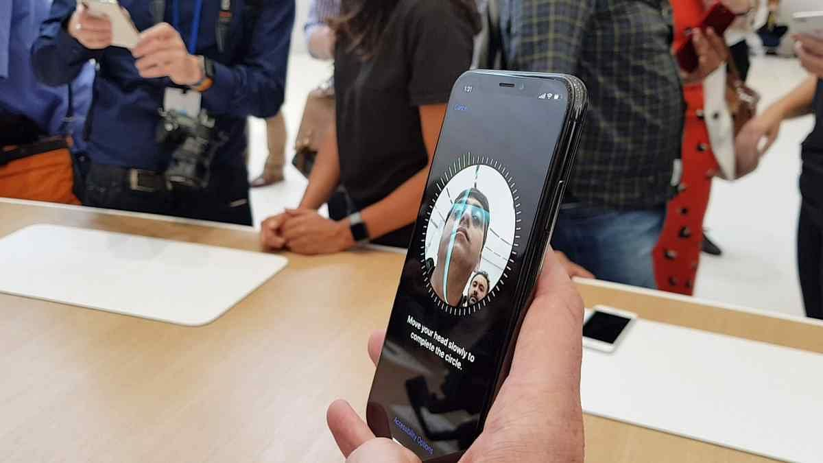 Face ID was first introduced on the iPhone X by Apple.