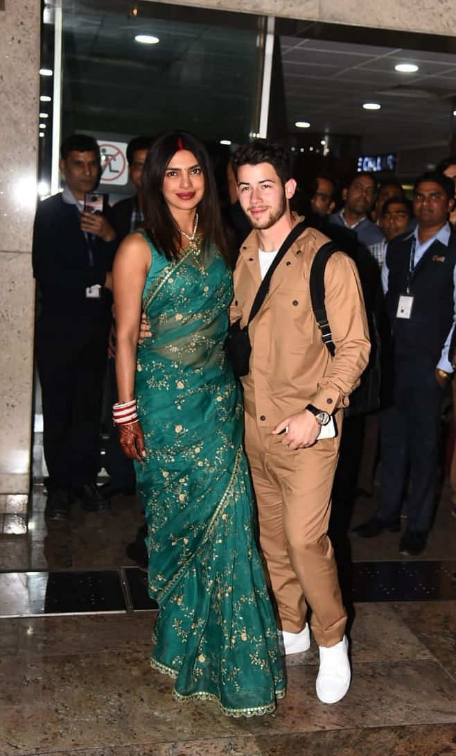 Priyanka and Nick were seen arriving at the New Delhi airport.