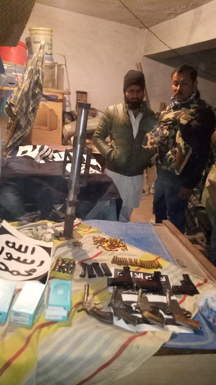 Arms and ammunition seized during NIA raids in connection with a new ISIS-inspired module styled as 'Harkat ul Harb e Islam'.