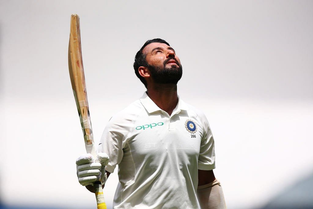 Cheteshwar Pujara celebrates after reaching his 17th Test hundred on Day 2 of the Boxing Day Test at MCG.