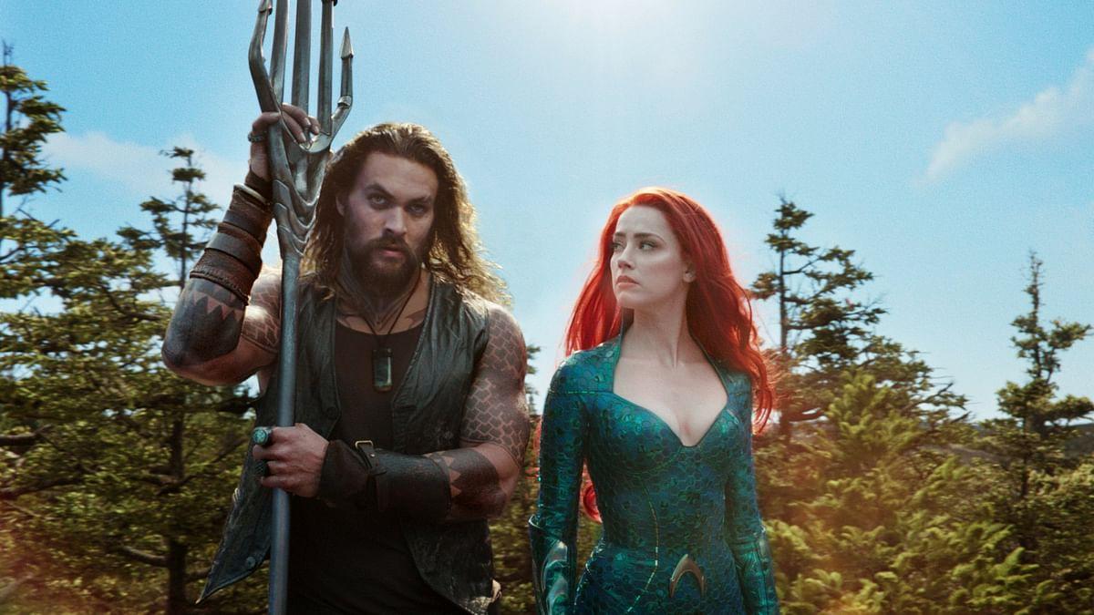 Jason Momoa and Amber Heard in <i>Aquaman.</i>