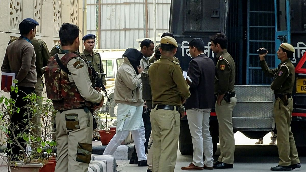 The 10 accused arrested in ISIS case being taken to court from the NIA headquarter in New Delhi