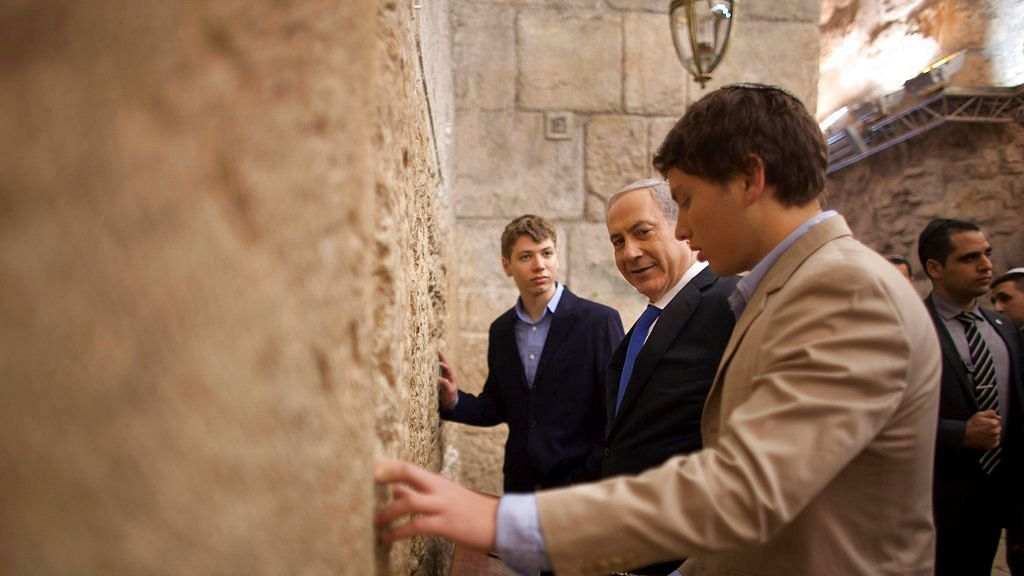 Israeli Prime Minister Benjamin Netanyahu (centre) prays with his sons Yair Netanyahu (left) and Avner Netanyahu at the Western Wall.
