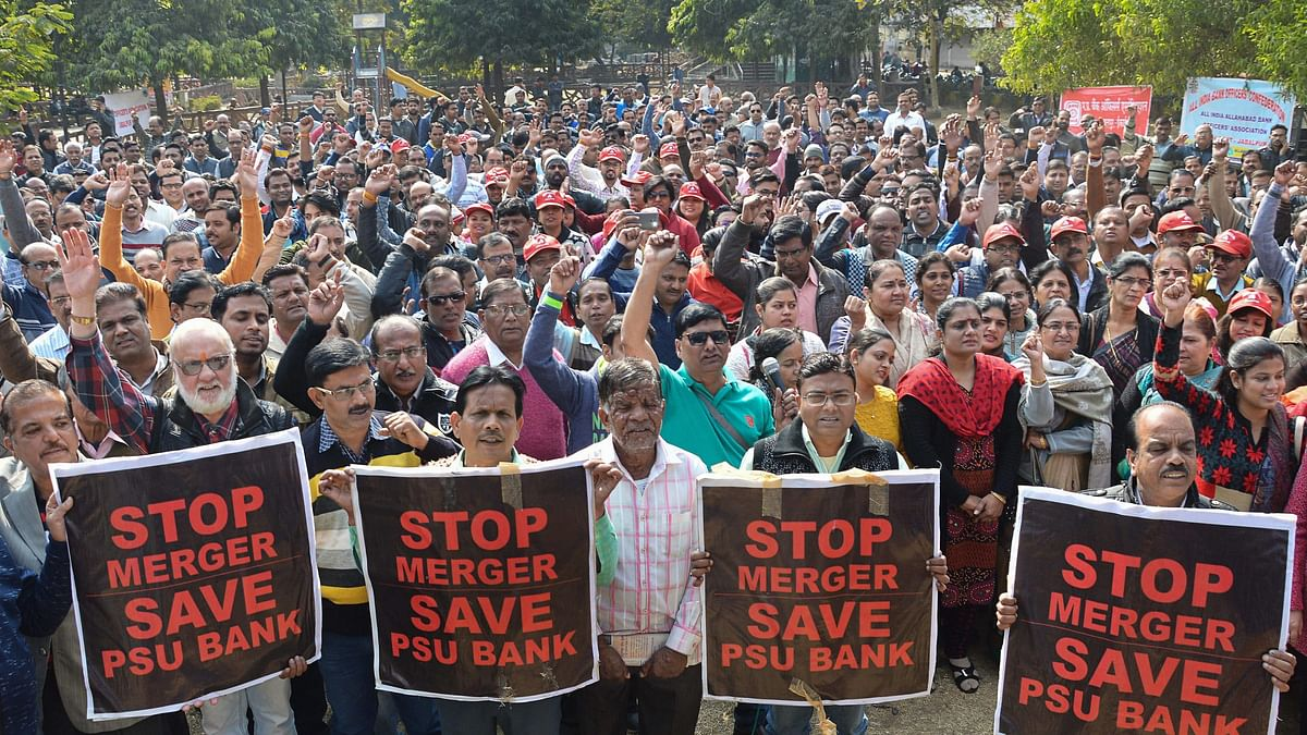 Bank employees stage a protest against the proposed merger of Vijaya Bank and Dena Bank with Bank of Baroda, during a strike at JDA garden in Jabalpur on 26 December.
