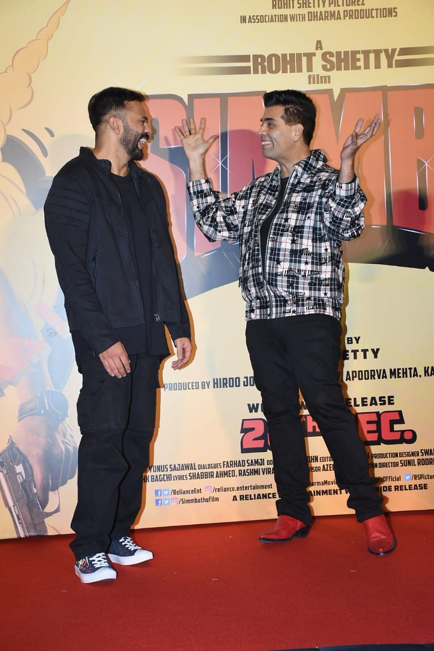 Rohit Shetty and Karan Johar share a laugh.