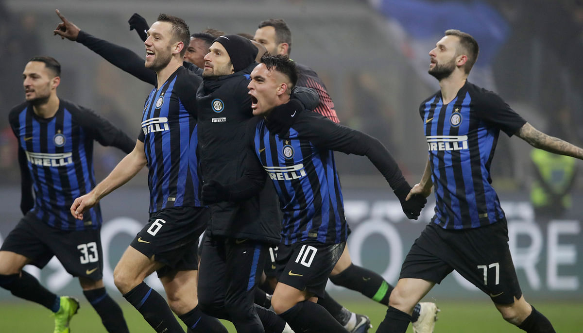 Inter Milan's Lautaro Martinez celebrates with his teammates at the end of a Serie A soccer match between Inter Milan and Napoli, at the San Siro stadium in Milan, Italy, Wednesday, Dec.26, 2018.