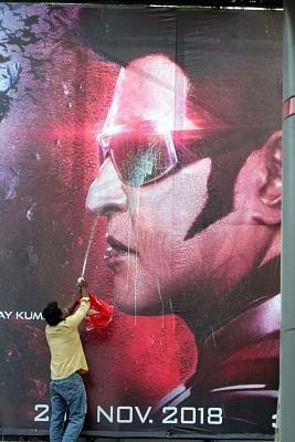 "Chennai: A Rajinikanth fan washes the ""2.0"" film poster as he celebrates the release of the film in Chennai, on Nov 29, 2018. (Photo: IANS)"