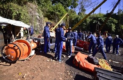 Ksan: Navy personnel involved in rescue operations at the site where 15 miners are trapped inside an illegal coal mine filled with water for two weeks now, in Ksan of Meghalaya