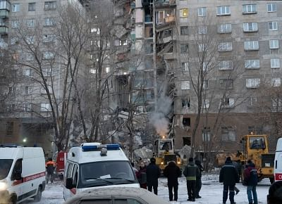 MAGNITOGORSK, Dec. 31, 2018 (Xinhua) -- A residential building is seen partially destroyed after a gas explosion in the industrial city of Magnitogorsk,  Russia, Dec.31, 2018. At least four people were killed and 35 others remained missing after a household gas explosion rocked a residential building in the Russian city of Magnitogorsk on Monday, the Russian Emergencies Ministry said. (Xinhua/Sputnik/IANS)