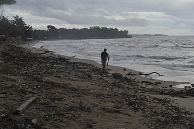 BANTEN, Dec. 26, 2018 (Xinhua) -- A man walks on Anyer beach in Serang, Banten Province, Indonesia, Dec.26, 2018. Over 430 people have been killed along the coastal areas of Sunda Strait in the wake of Saturday