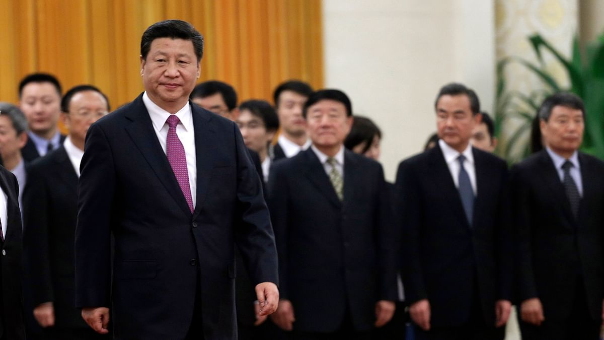 File photo of China's President Xi Jinping in front of Chinese senior officials during a welcoming ceremony at the Great Hall of the People in Beijing.