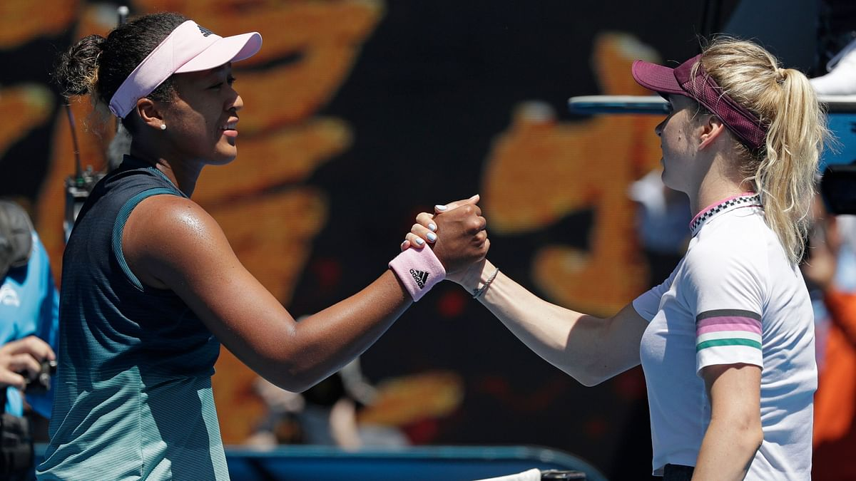 Naomi Osaka and Elina Svitolina meet at the net after the Japanese fourth seed won their quarter-final clash at the Australian Open.