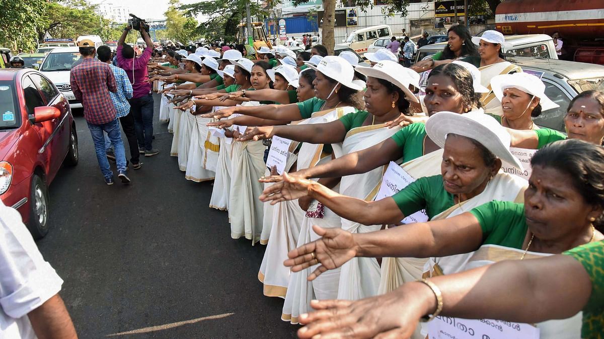 Thousands of women take pledge while participating in the women's wall against communalism and gender discrimination in Kochi on 1 January.