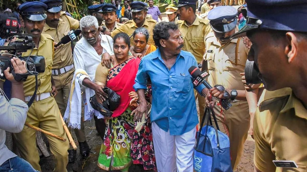 Devotees enter Kerala's Sabarimala Temple after the gates were opened  to all devotees, including mentruating women.