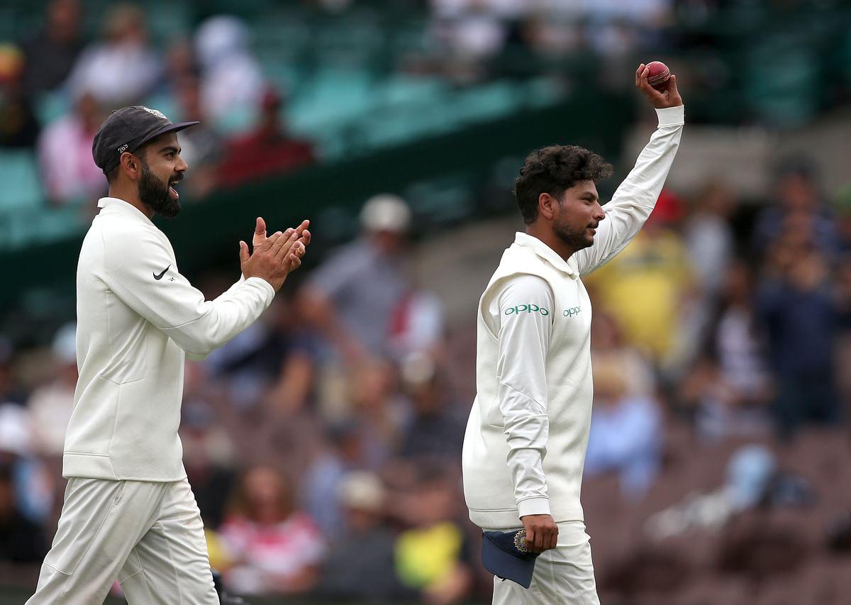 Kuldeep Yadav celebrates after finishing with career-best figures of 5/99 in the Sydney Test.