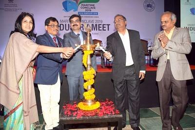 Kolkata: Federation of Indian Chambers of Commerce and Industry (FICCI) Director (Infrastructure) Neerja Singh, Ministry of Shipping Director (Port) Arvind Chaudhary, Kolkata Port Trust (KoPT) Chairman Vinit Kumar, Haldia Dock Complex (HDC) Deputy Chairman G. Senthilvel and KoPT Deputy Chairman S. Balaji Arun Kumar light the lamp to inaugurate Maritime Conclave 2019 at East Coast Railway Stadium in Bhubaneswar, on Jan 29, 2019. (Photo: IANS)