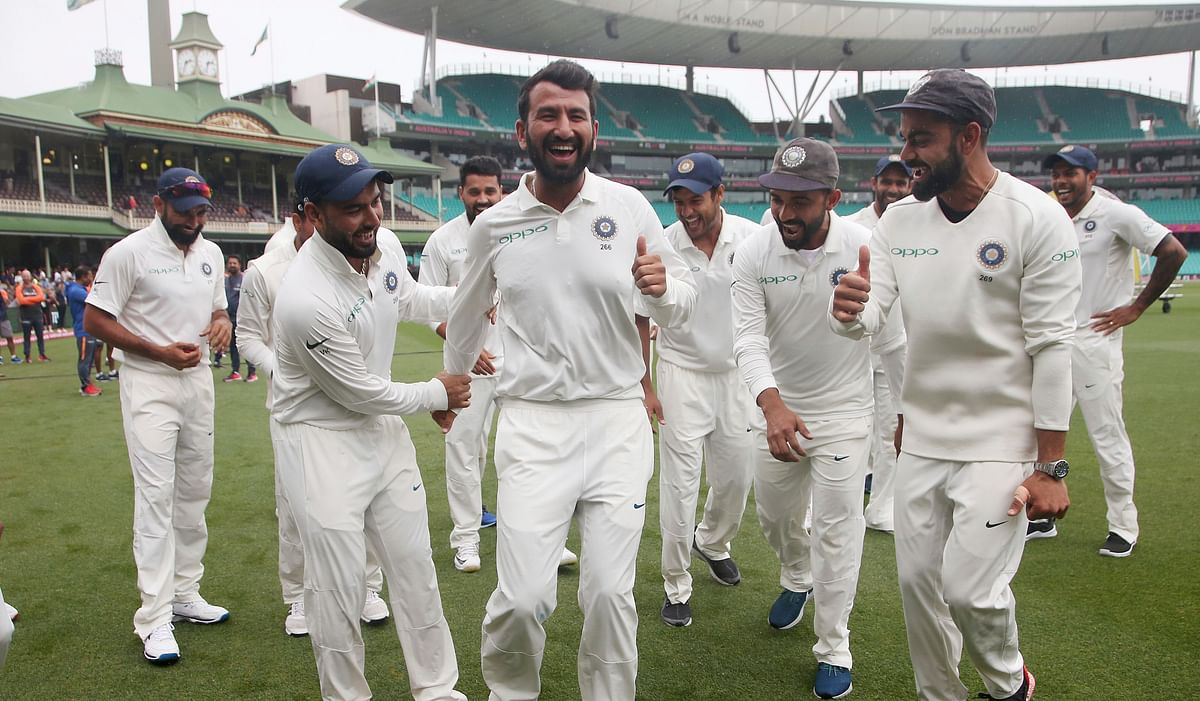 Cheteshwar Pujara enjoys a light moment with his teammates during a victory dance after the series win in Sydney.