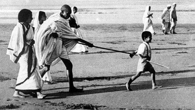 Kanu Gandhi was the little child holding Mahatma's stick in this iconic Dandi march photo