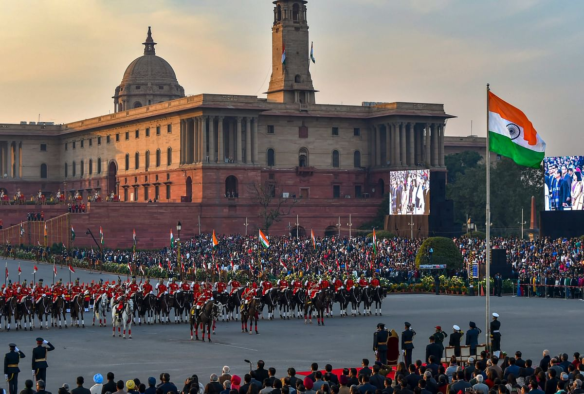 The national flag is unfurled as President Ram Nath Kovind and tri-services chiefs salute during the Beating Retreat ceremony at Vijay Chowk in New Delhi.
