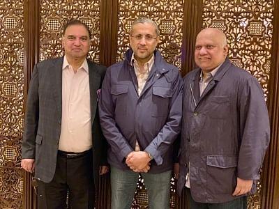 Emirati business tycoon Rashid Al-Habtoor (C).