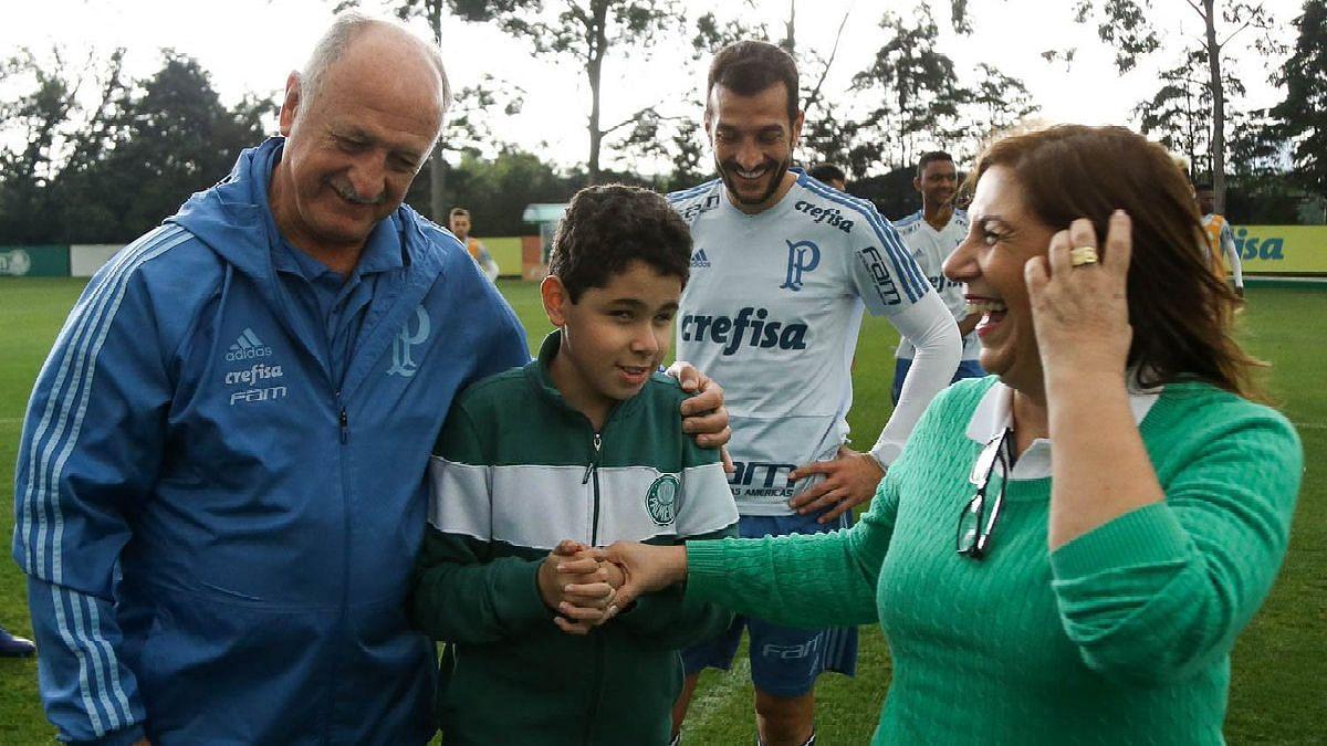 Silvia and Nickollas with Palmeiras coach Luiz Felipe Scolari.