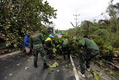 NAKHON SI THAMMARAT, Jan. 5, 2019 (Xinhua) -- Rescuers clean a road in Pak Phanang district, Nakhon Si Thammarat province of Thailand, Jan. 5, 2019. Tropical storm Pabuk has killed three people and prompted an evacuation of more than 34,000 villagers in southern Thailand, a senior government official said on Saturday. (Xinhua/IANS)
