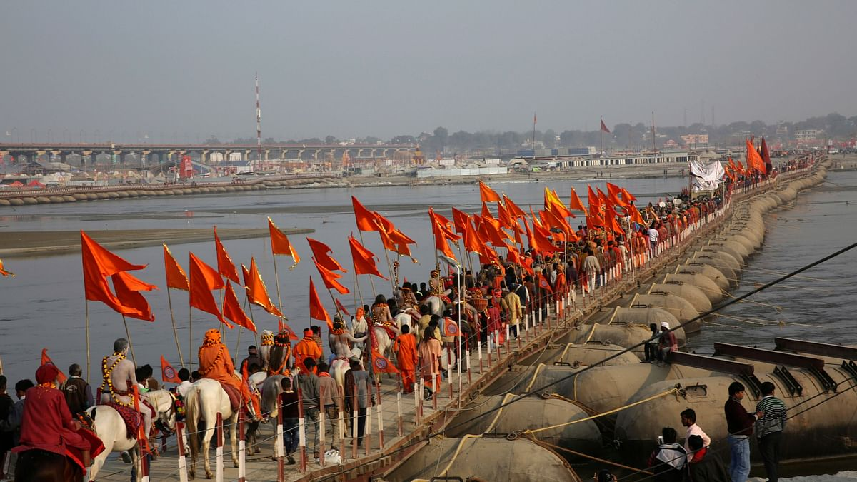 Naga Sadhus, or Hindu holy men, participate in a procession towards the Sangam, the confluence of rivers Ganges and Yamuna, ahead of the Kumbh Mela in Allahabad.