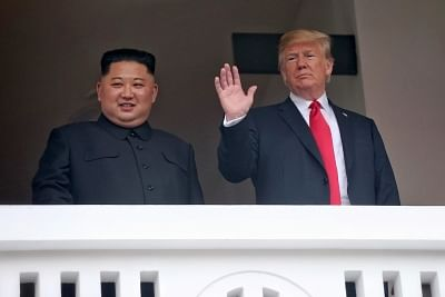 Singapore: U.S. President Donald Trump waves on the veranda of the Capella Hotel in Singapore on June 12, 2018, while having a one-on-one summit with North Korean leader Kim Jong-un in this photo provided by Singapore