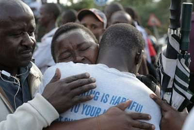 NAIROBI, Jan. 15, 2019 (Xinhua) -- People embrace each other after an evacuation near the site of an attack at an upmarket hotel and office complex in Nairobi, Kenya, on Jan. 15, 2019. At least three people have been confirmed dead and several others injured following an attack at an upmarket hotel and office complex in Nairobi on Tuesday, police said. (Xinhua/Lyu Shuai/IANS)