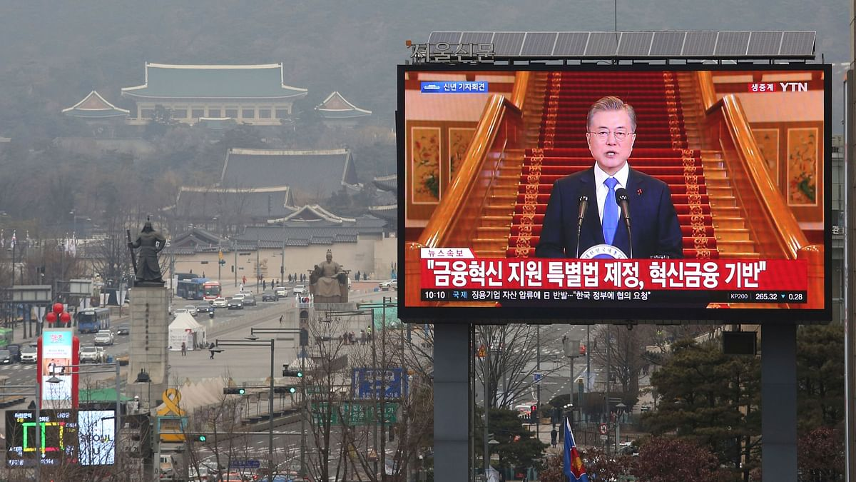 A TV screen shows the live broadcast of South Korean President Moon Jae-in's press conference in Seoul, South Korea, Thursday, 10 January 2019.