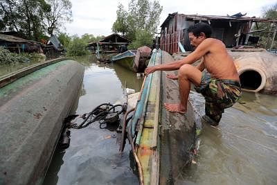 NAKHON SI THAMMARAT, Jan. 5, 2019 (Xinhua) -- A resident checks a boat damaged by tropical storm in Pak Phanang district, Nakhon Si Thammarat province of Thailand, Jan. 5, 2019. Tropical storm Pabuk has killed three people and prompted an evacuation of more than 34,000 villagers in southern Thailand, a senior government official said on Saturday. (Xinhua/IANS)