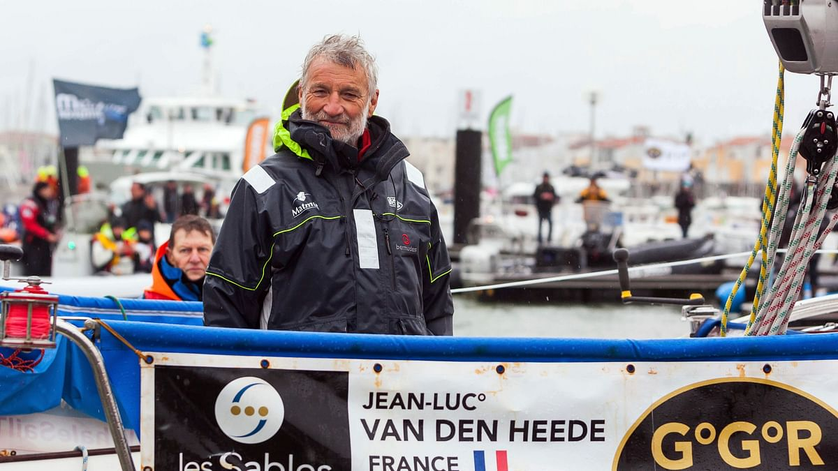 French sailor Jean-Luc Van Den Heede, 73, arrives aboard his Rustler 36, Matmut, after winning the Golden Globe Race, a single-handed round the world yacht race, after 212 days alone at sea, in Les Sables-d'Olonne harbor, western France, Tuesday, Jan. 29, 2019.