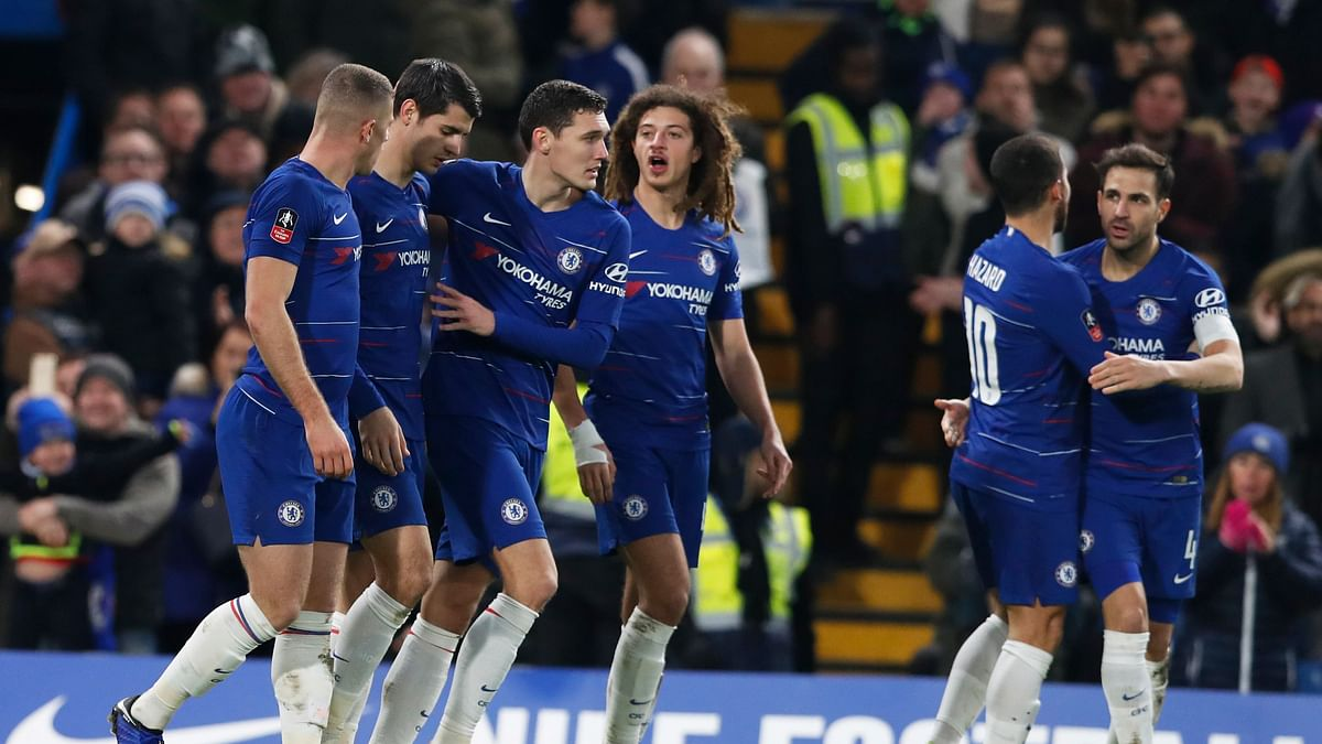 Titleholder Chelsea progressed to the last 32 after a 2-0 win over second-tier Nottingham Forest.