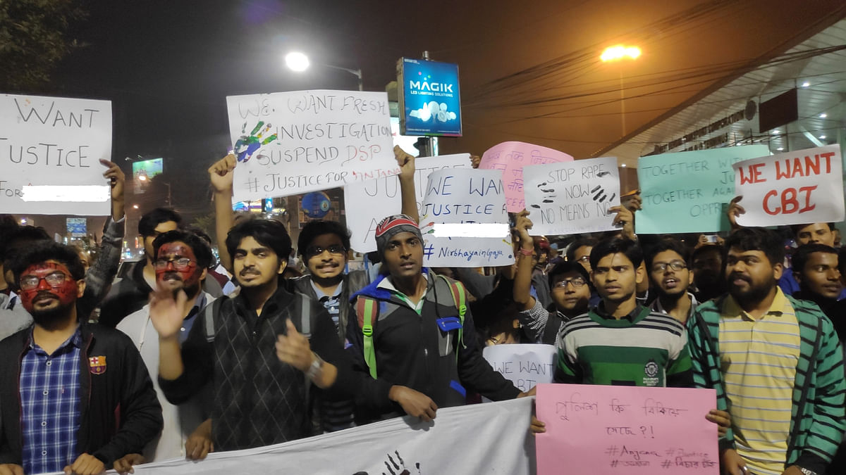 Students shout slogans at the protest.