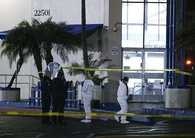 LOS ANGELES, Jan. 5, 2019 (Xinhua) -- Investigators and police officers work at the scene of a fatal shooting in Torrance, the United States, Jan. 5, 2019. Three people have been killed and four others injured in a shooting at the Gable House Bowl in the U.S. coastal city of Torrance near Los Angeles, the Torrance Police Department said Saturday. (Xinhua/Zhao Hanrong/IANS)