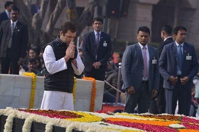 New Delhi: Congress president Rahul Gandhi pays tribute to Mahatma Gandhi on his death anniversary at Raj Ghat in New Delhi on Jan. 30, 2019. (Photo: IANS)