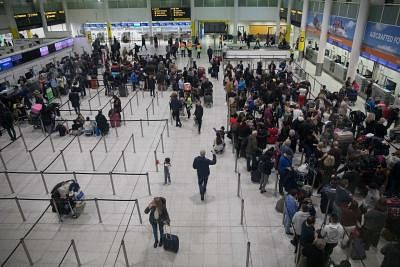 """LONDON, Dec. 21, 2018 (Xinhua) -- Photo taken on Dec. 21, 2018 shows a general view of the departures area at the South Terminal in Gatwick Airport where large queues have formed after drones caused the airport to shut down for more than a day in London, Britain. British military was called in on Thursday to provide assistance to police over Gatwick drone disruption, which is reported to have left thousands of Christmas holidaymakers to face """"several days"""" of problems at the London airport.  (Xi"""